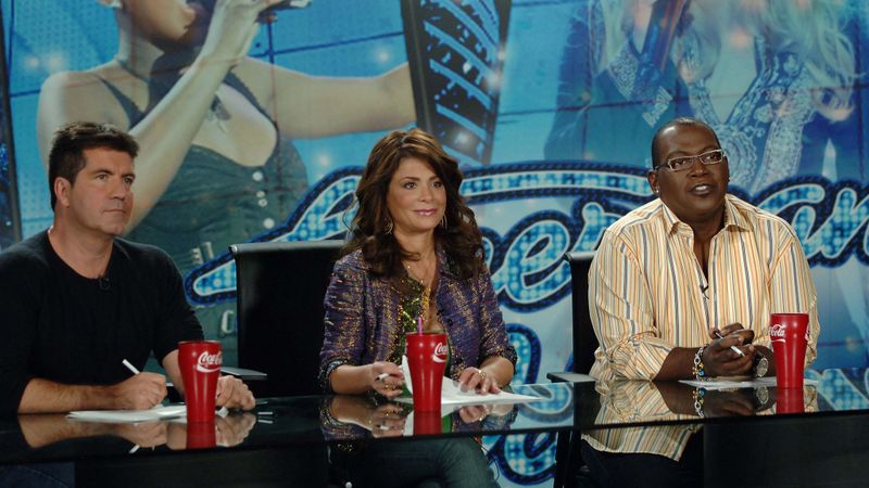"""Judges Simon Cowell, left, Paula Abdul and Randy Jackson prepare for an audition during Season 5 of """"American Idol."""" It was Murdoch who urged Fox executives to pick up the singing competition in 2002. It eventually became the top show in the country."""